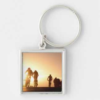 Mountain Bike Riders Make Their Way Over The Top Keychain