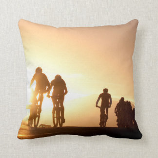 Mountain Bike Riders Make Their Way Over The Top Throw Pillow