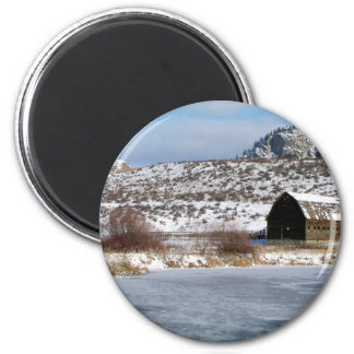 Mountain farm in winter magnet