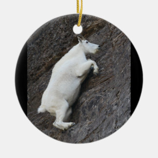 mountain goat climbing cliff ceramic ornament
