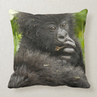 Mountain Gorilla, baby riding on mothers back Throw Pillows