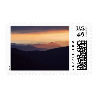 Mountain landscape with a fantastic sunset postage