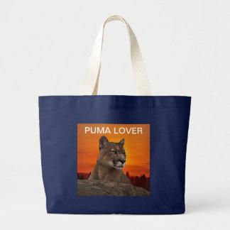 Mountain lion at sunset large tote bag