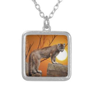 Mountain lion at sunset pendants