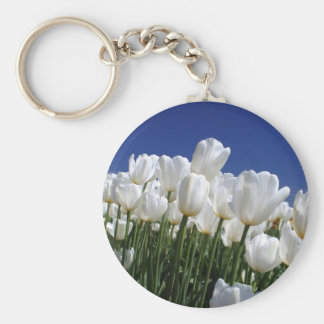 Mountain of white tulips against a blue sky keychain