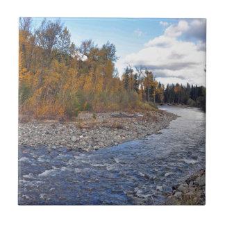 Mountain stream in autumn forest ceramic tile