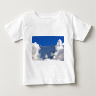 Mountain top flanked by clouds