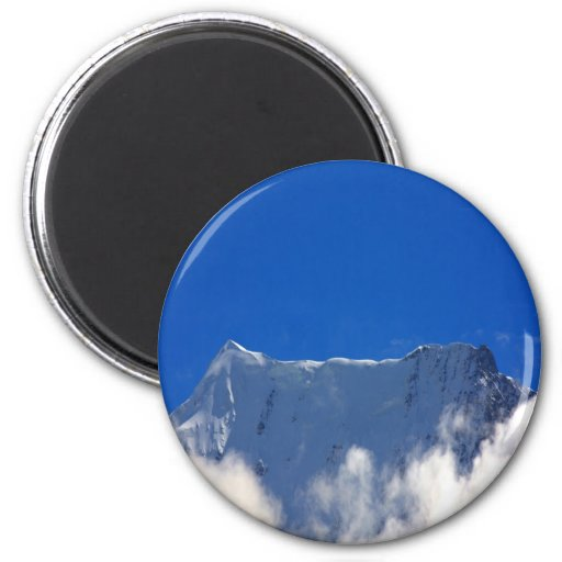 Mountain top over clouds 2 inch round magnet