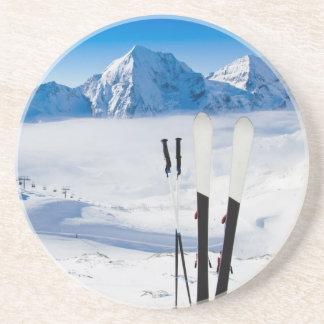 Mountains and ski equipment coaster