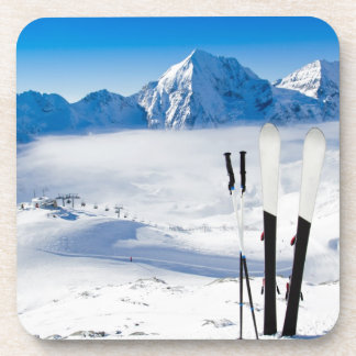 Mountains and ski equipment drink coaster