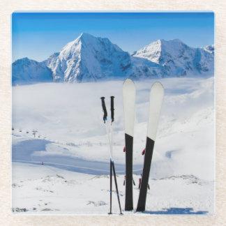 Mountains and ski equipment glass coaster