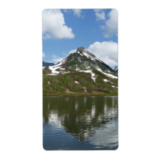 Mountains landscape: reflection of mount in lake label