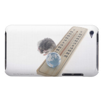 Mouse grooming beside thermometer with model of iPod touch case