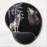 "Mouse Pad Wolf howling Imagery of His Mate in Ski<br><div class=""desc"">This wildlife mouse pad tells the story of a wolf, after losing his maid is howling lonely into the cold winter night. The image in the night sky represents the memories of the missing companion. The Wolf mates for life. Therefore, it is tragic that hunters get paid to kill these...</div>"