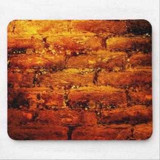 Mousepad anaranjado de la pared de ladrillo