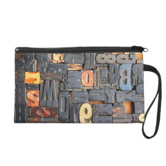 movable type wristlet
