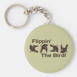 Mover de un tirón el pájaro llavero redondo tipo pin