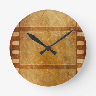MOVIE REEL OLD-FASHIONED GRUNGE GOLD BACKGROUND DI ROUND WALL CLOCKS