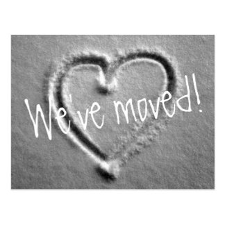 Moving postcards with drawn heart in snow