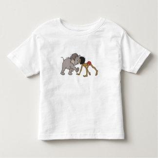 Mowgli del libro de la selva con el elefante playera de bebé