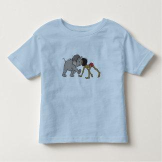 Mowgli del libro de la selva con el elefante remeras
