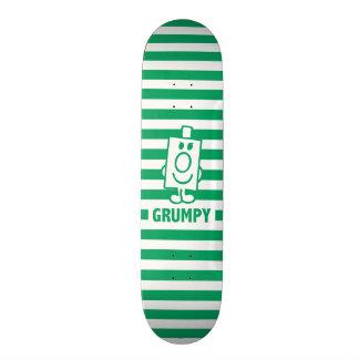 Mr Grumpy | Mischievous Grin and Green Stripes Skateboard Deck