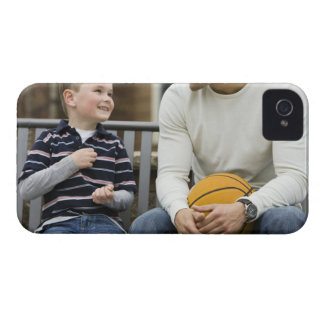 MR Man (age 25) and boy (age 6) sitting on park iPhone 4 Cover
