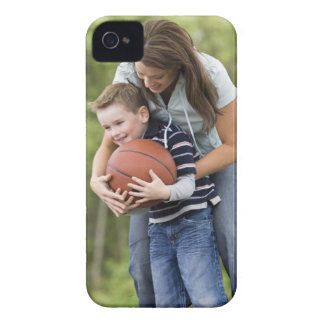 MR mother (age 26) playing basketball with son iPhone 4 Cover