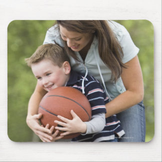 MR mother (age 26) playing basketball with son Mouse Pad