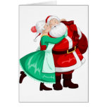 Mrs Claus Kisses Santa On Cheek And Hugs Card
