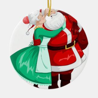 Mrs Claus Kisses Santa On Cheek And Hugs Ceramic Ornament
