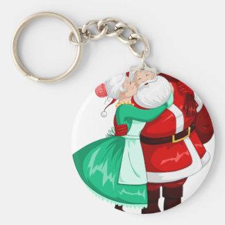 Mrs Claus Kisses Santa On Cheek And Hugs Keychain