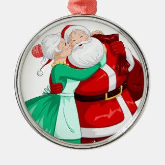 Mrs Claus Kisses Santa On Cheek And Hugs Metal Ornament