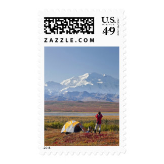 Mt. McKinley towers behind a camper and his tent 3 Postage Stamps