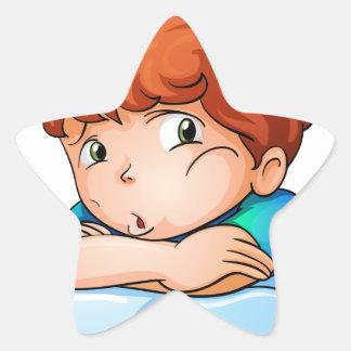 Muchacho aburrido pegatina en forma de estrella