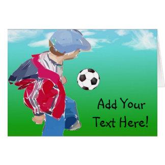 Muchacho con fútbol tarjeta de felicitación