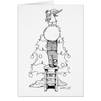Muchacho con un ángel del navidad tarjeta de felicitación