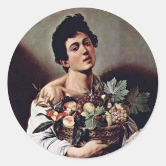 Muchacho con una cesta de fruta de Miguel Ángel Pegatina Redonda