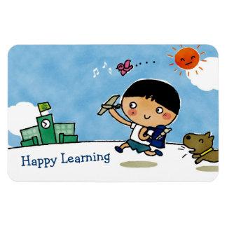 Muchacho de aprendizaje feliz que dirige a la escu iman flexible