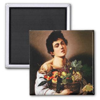 Muchacho de Caravaggio con una cesta de imán de la