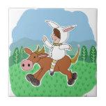 Muchacho del conejito que monta un caballo azulejo