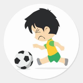 Muchacho del fútbol etiquetas redondas