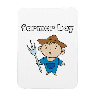 Muchacho del granjero imán