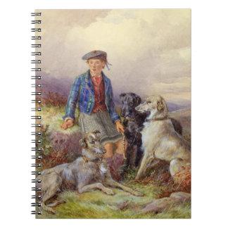 Muchacho escocés con los wolfhounds en un landsca  libretas