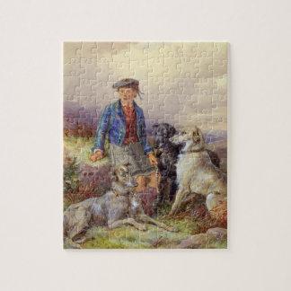 Muchacho escocés con los wolfhounds en un landsca  puzzle
