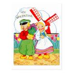 Muchacho holandés y chica de la tarjeta del día de postal