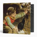 Muchacho joven con los pájaros en la nieve