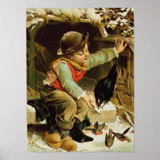 Muchacho joven con los pájaros en la nieve póster