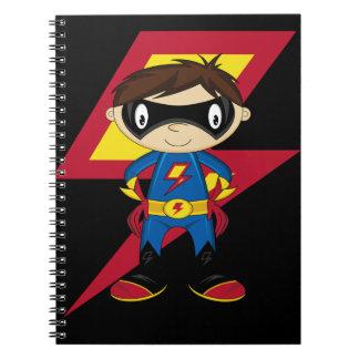 Muchacho lindo del super héroe libros de apuntes