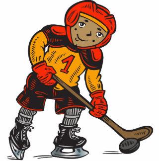 Muchacho que juega a hockey escultura fotografica